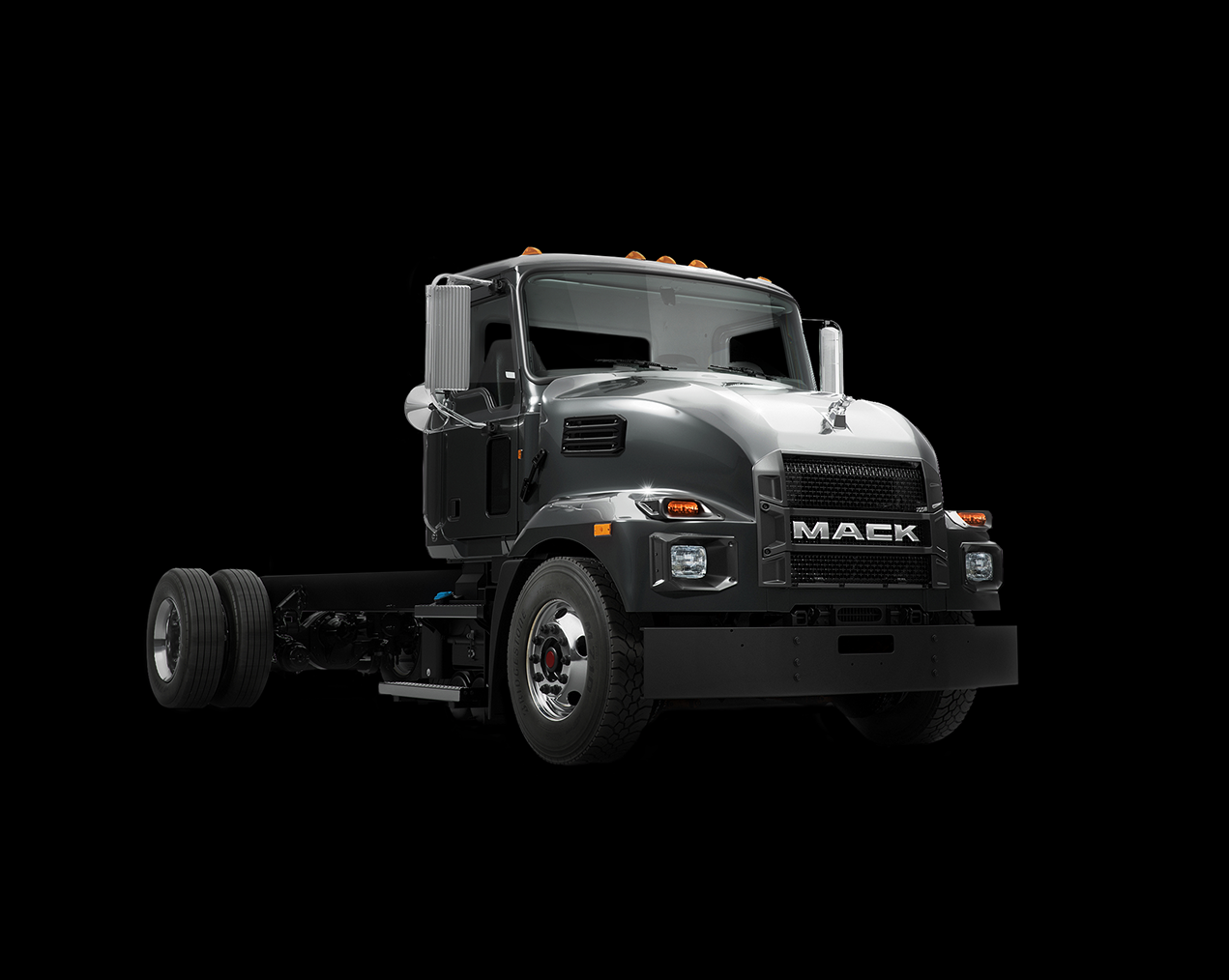 A black Mack MD Series truck with searchable exterior features.