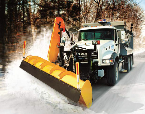 a Mack Truck plowing snow