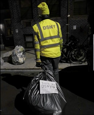New-York-City-Department-of-Sanitation worker carrying refuse and recyclables