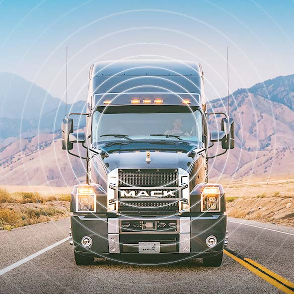 Mack Anthem on a mountain highway with radiating circles overlay
