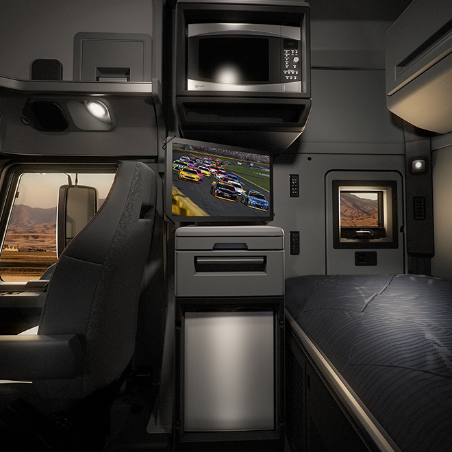 "Profile view of the Anthem 70"" Stand Up Sleeper interior environment with microwave, television, refrigerator and sleeper bunk."